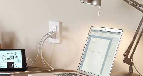 Laptop and iPad plugged into a USB outlet