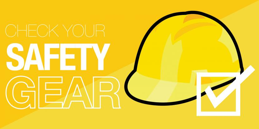 A yellow hard hat with a white check mark in front of it