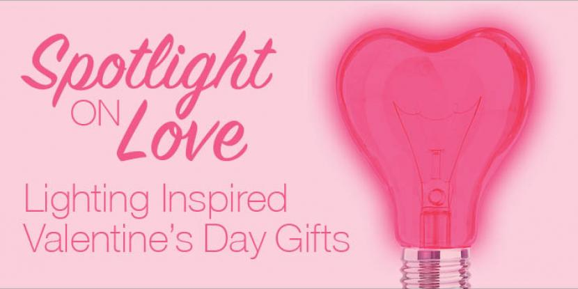 Heart shaped lightbulb lit up in a pink color