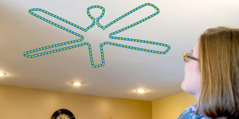 fan icon on the ceiling while a person is staring at the ceiling wondering how to install a fan